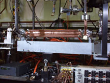 Two-foot long linear particle accelerator section