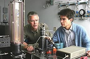 Chris Shaddix, left, and Alejandro Molina discuss an experiment to determine the best proportion of oxygen and CO2 for oxy-combustion of coal. Molina's small-scale experiments have established the groundwork to bring two other larger CRF (Combustion Research Facility) reactors into the research.
