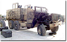 A gun truck, with an armor kit developed by Lawrence Livermore National Laboratory researchers and engineers, was struck by an improvised explosive device on March 23, 2005, southwest of Fallujah, Iraq. All seven U.S. soldiers in the vehicle at the time of the attack walked away unharmed.