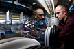NREL scientist Robert Tenant manipulates an ink-jet sprayer in a glove box. Tenant is incorporating thin-film design and manufacturing processes to improve the performance and lower the cost of dynamic windows.