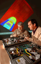 CYBERSPACE DOOR — Lyndon Pierson (left) and Perry Robertson examine their group's video encoder and decoder.