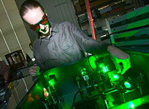 Matthew Pelton of Argonne�s Center for Nanoscale Materials adjusts a green laser used to monitor the sporadic blinking of quantum dots.