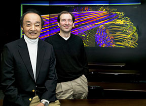 PPPL Chief Scientist Bill Tang (left) and PPPL computational scientist Stephane Ethier are at the Lab�s High-Resolution Wall. In the background is a plasma turbulence simulation.